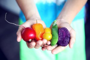 Hands with assorted vegetables